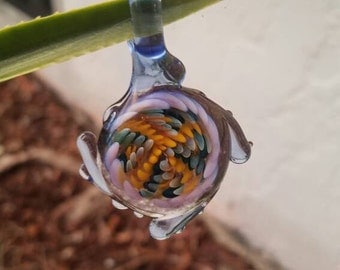 Borosilicate glass pendant with purple and yellow implosion fingers