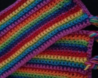 Handmade crochet rainbow hairband with plaited ties.