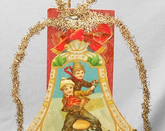1910s Antique Christmas Ornaments, VICTORIAN Paper SCRAP Tinsel Christmas Ornament with Two Boys Sledding, RARE Old Antique Paper Ornaments