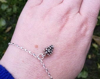 Sterling silver chain bracelet, With a solid silver mini pine cone charm, modern boho forest jewellery.