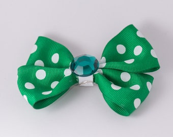 green and gold polka dot bow with green gem