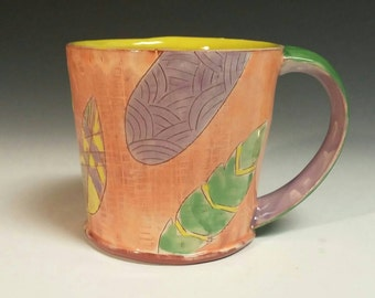 Textured Earthenware mug - orange with feathers