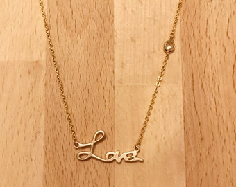 Matte gold love necklace with clear glass stone