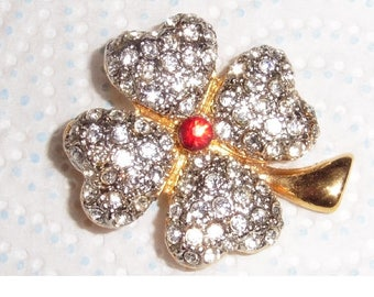 Vintage Rhinestone flower Brooch. Gold plated. red centre stone