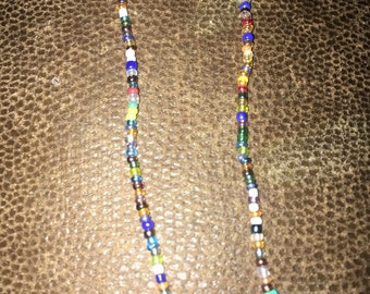 """Tiny multi colored glass beads stretchy necklace. About 30"""" in length"""