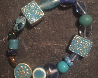 Blue glass, ceramic and wooden beaded stretchy bracelet