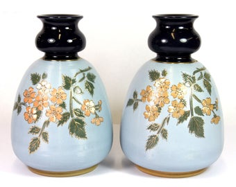 A pair of early 20th century Langley Mill stoneware vases, H. 20cm.