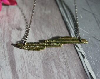 Unique one off cast brass pendant