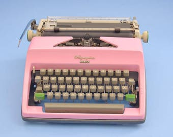 Pink 60s typewriter Olympia Monica