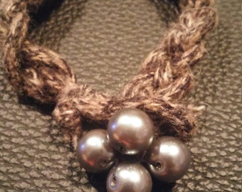 Braided yarn bracelet with bead closure