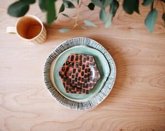 set of textured dinner tapas plates