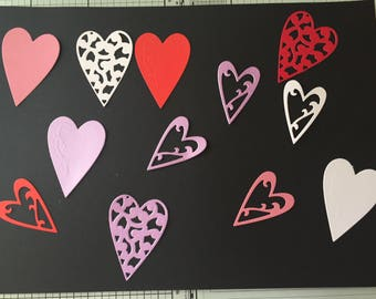 12 assorted love heart die cuts, 3 designs, 3 colours (pink, purple and red). Ideal for valentines day or an anniversary, wedding