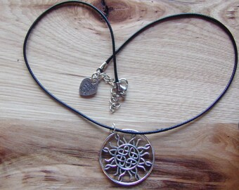 N305 Large Metal Celtic Symbol on a leather cord