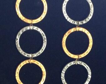 Metallic circular drop earrings . Costume jewelry .