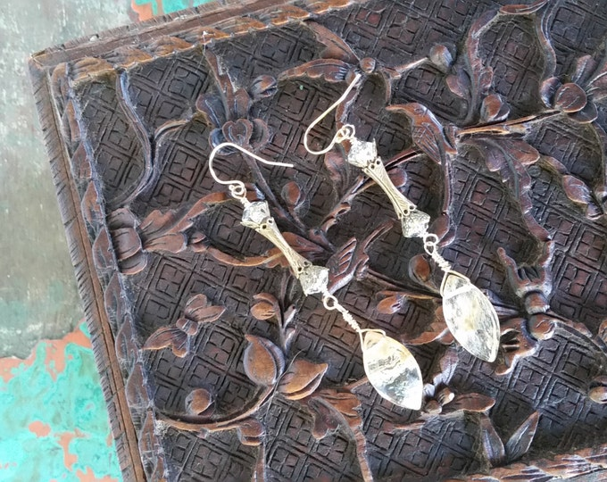 Besautiful and Very Unusual Brass Pieces in these Earrings. The Bottom Dangle is a Large Gold Rutilated Quartz Briolette