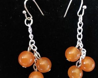 Orange stone bead dangle earrings