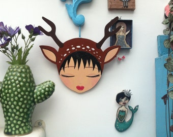 Deer head on the wall, wall, girl for zoownatas
