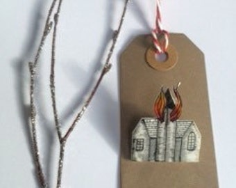 Little hand made brooch of a little house on fire!! Each one hand drawn and unique!