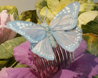 Peinecillo with butterfly blue clear of feathers for the hair