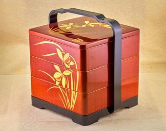 SALE 15% coupon: 15OFF. Bento box - three levels red box set with tray and handle. Made of hard plastic and decorated with narcissus.