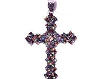 Silver cross pendant and precious stones