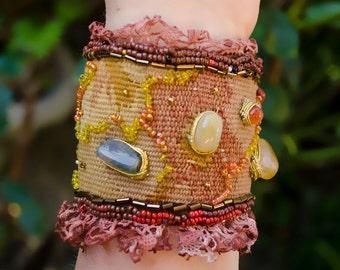 Bracelet in fabric inlaid with semi precious stones