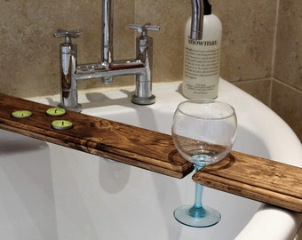 Bath shelf with wine and candle holders