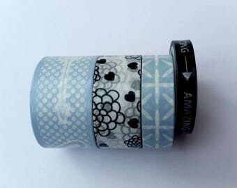Set of 4 washi tapes, different sizes, blue and black.