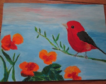 Tanager bird with orange flowers