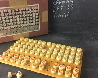 German word game with peg letters WORTER SPIEL