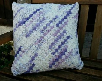 A handmade variegated yarn corner to corner (c2c) cushion
