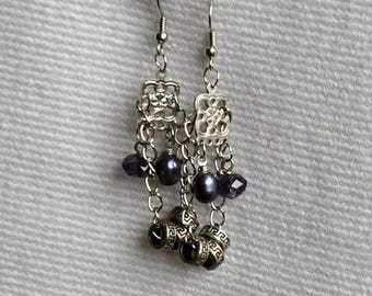 Unique and handmade. Earrings dangle, silver, glass beads and mother of Pearl