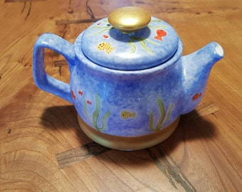 Teapot hand decorated with an underwater theme