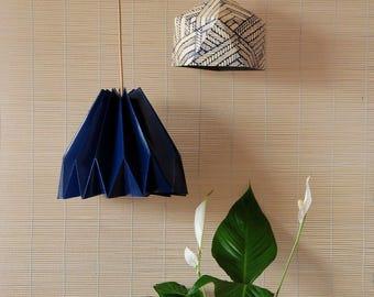 Origami fold pendant lamp made with geometric print.
