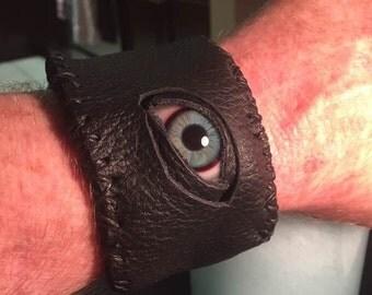 Leather bracelet with glass eye
