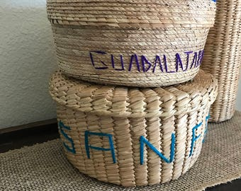 Woven straw set of 2 baskets