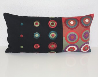 Multicolored cotton cushions embroidered on black fabric
