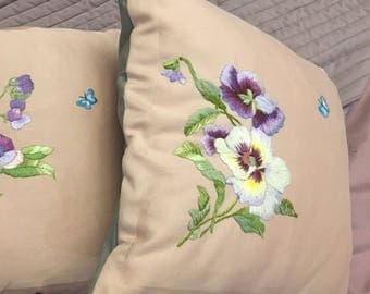 Decorative pillow is hand embroidered lilac Hibiscus