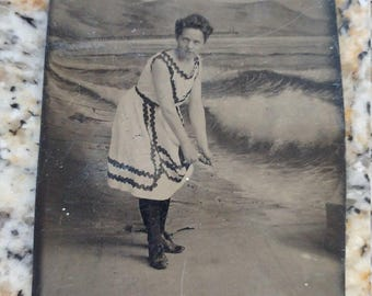 All Wet:  Antique Tintype of Woman in Bathing Suit/Costume Posing in a Seaside Studio Set