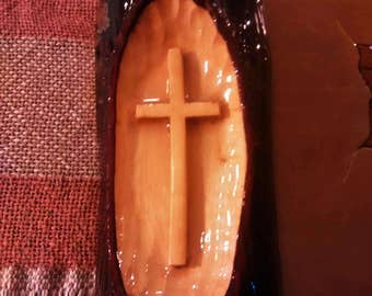 glossy wood cross carved in hickory wood