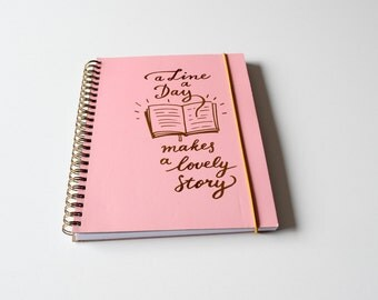 A5 spiral bound hardcover notebook with rosegold text