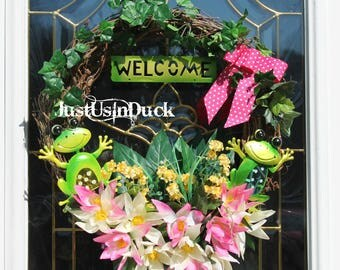 Spring summer frog welcome 18 inch grapevine wreath.  Frogs lilly pads, frogs, polka dot ribbon.  Happy frog wreath