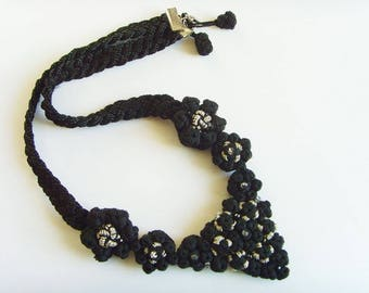 Necklace black silver beads silk thread.