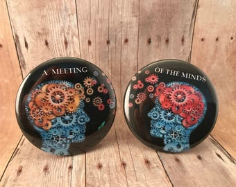 "Button duo: ""A meeting of the minds"" 2 inch pin back buttons"