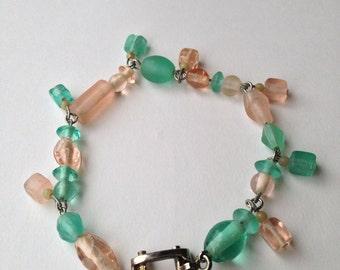 Green and peach dangle beaded bracelet