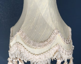 A pretty vintage cream coloured small lampshade.