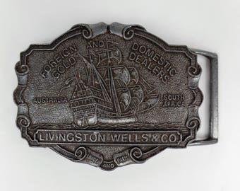 Livingston Wells & Co Belt Buckle / Foreign and Domestic Gold dealers / Nautical Pirates Sail Ship / Pot Metal Gray Color / Vintage 70s