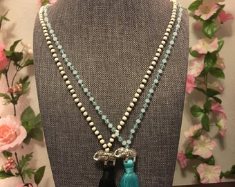 Beaded long necklace with silver elephant and teal/black tassel