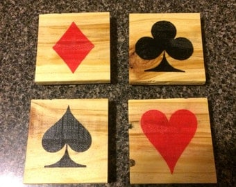 Playing card suit coasters made from pallet wood
