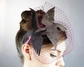 Grey leather bird headpiece with birdcage veiling